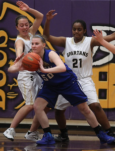 Sarah Nader - snader@shawmedia.com Sycamore's Katherine Kohler (left) guards Burlington Central's Becca Gerke with the help of Sycamore's Taiya Hopkins during the third quarter of Monday's Class 3A Belvidere Sectional on February 24, 2014. Burlington Central won defeated Sycamore, 42-28.