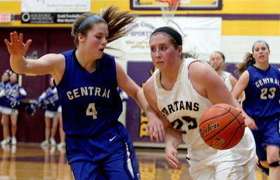 Sarah Nader - snader@shawmedia.com Burlington Central's Kayla Ross (left) guards Sycamore's Bailey Gilbert during the third quarter of Monday's Class 3A Belvidere Sectional on February 24, 2014. Burlington Central won defeated Sycamore, 42-28.