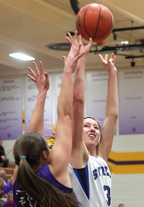 Sarah Nader - snader@shawmedia.com Woodstock's Cody Brand shoots during the second quarter of Monday's Class 3A Belvidere Sectional against Rockford Lutheran on February 24, 2014. Woodstock lost, 57-67.