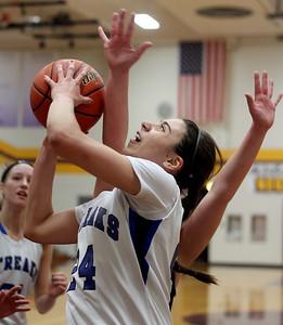 Sarah Nader - snader@shawmedia.com Woodstock's Selena Juarez shoots during the first quarter  of Monday's Class 3A Belvidere Sectional against Rockford Lutheran on February 24, 2014. Woodstock lost, 57-67.