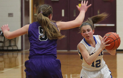 Sarah Nader - snader@shawmedia.com Rockford Lutheran's Kayla Koehler (left) guards Woodstock's Grace Beattie while she brings the ball towards the basket during the fourth quarter of Monday's Class 3A Belvidere Sectional on February 24, 2014. Woodstock lost, 57-67.
