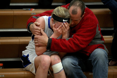 Sarah Nader - snader@shawmedia.com Woodstock's Cody Brand gets a hug after her team lost to Rockford Lutheran  during  Monday's Class 3A Belvidere Sectional on February 24, 2014. Woodstock lost, 57-67.
