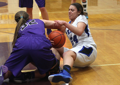 Sarah Nader - snader@shawmedia.com Rockford Lutheran's Abby Woolacott (left) and Woodstock's Selena Juarez fight over the ball during the second quarter of Monday's Class 3A Belvidere Sectional on February 24, 2014. Woodstock lost, 57-67.