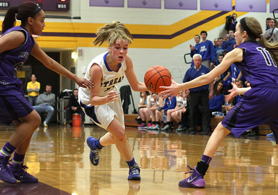 Sarah Nader - snader@shawmedia.com Woodstock's Colleen Brown (center) brings the ball towards the basket during the third quarter of Monday's Class 3A Belvidere Sectional on February 24, 2014. Woodstock lost, 57-67.