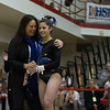 Gevena Coach Kim Hostman hugs Geneva's Claire Rose Ginsberg after her performance on the Uneven Parallel Bars at The Girls Gymnastics State Meet at Palatine High School in Palatine, IL on Saturday, February 22, 2014 (Sean King for Shaw Media)
