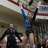 Geneva's Claire Rose Ginsberg sticks the landing on the Uneven Parallel Bars at The Girls Gymnastics State Meet at Palatine High School in Palatine, IL on Saturday, February 22, 2014 (Sean King for Shaw Media)