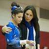 Geneva Coach Kim Hostman gives last minute instructions to Geneva's Claire Rose Ginsberg before she takes the Uneven Parallel Bars at The Girls Gymnastics State Meet at Palatine High School in Palatine, IL on Saturday, February 22, 2014 (Sean King for Shaw Media)