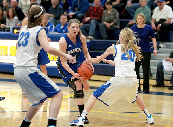 Geneva's Michaela Loebel goes to the basket during their Wheaton North Regional game against Wheaton North Feb. 20.