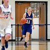Geneva's Michaela Loebel dribbles down court during their Wheaton North Regional game against Wheaton North Feb. 20.