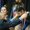 Geneva's Claire Rose Ginsberg receives her first place all around award at The Girls Gymnastics State Meet at Palatine High School in Palatine, IL on Saturday, February 22, 2014 (Sean King for Shaw Media)