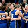 Geneva's Michaela Loebel (11) celebrates with her teammates following their Wheaton North Regional win against Wheaton North Feb. 20.