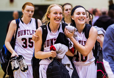 Kyle Grillot - kgrillot@shawmedia.com   Huntley freshman Morgan Clausen (center) and senior Samantha Andrews celebrate as the team walks off the court after beating South Elgin the girls class 4a sectional Tuesday in Crystal Lake. Huntley beat South Elgin, 49-32.