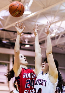 Kyle Grillot - kgrillot@shawmedia.com   South Elgin senior Kennede Miller (left) puts up a shot under pressure from Huntley senior Bethany Zornow during the first quarter of the girls class 4a sectional Tuesday in Crystal Lake. Huntley beat South Elgin, 49-32.