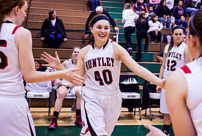 Kyle Grillot - kgrillot@shawmedia.com   Huntley senior Samantha Andrews is greeted by her teammates before the start of the girls class 4a sectional Tuesday in Crystal Lake. Huntley beat South Elgin, 49-32.