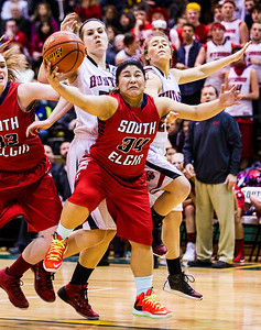 Kyle Grillot - kgrillot@shawmedia.com   South Elgin senior sophomore Nadia Yang puts up a shot under pressure from Huntley senior Bethany Zornow during the first quarter of the girls class 4a sectional Tuesday in Crystal Lake. Huntley beat South Elgin, 49-32.
