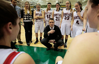 Kyle Grillot - kgrillot@shawmedia.com   Huntley head coach Paul Perrone talks with his players during a time out in the third quarter of the girls class 4a sectional Tuesday in Crystal Lake. Huntley beat South Elgin, 49-32.