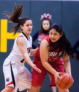 Kyle Grillot - kgrillot@shawmedia.com   South Elgin senior sophomore Nadia Yang (right) is guarded by Huntley sophomore Kayla Barreto during the first quarter of the girls class 4a sectional Tuesday in Crystal Lake. Huntley beat South Elgin, 49-32.
