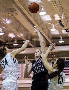 Kyle Grillot - kgrillot@shawmedia.com   Prairie Ridge sophomore Aly Clark (22) puts up a shot under pressure from Boylan junior Halle Stull (34) and senior Jensen Blassage during the first quarter of the girls class 4a sectional Tuesday in Crystal Lake. Boylan Catholic beat Prairie Ridge, 64-57.