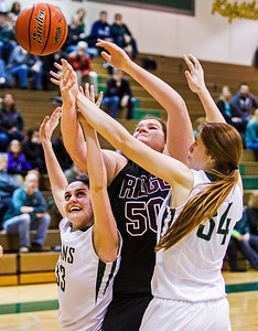 Kyle Grillot - kgrillot@shawmedia.com   Prairie Ridge senior Maddie Drain (50) and Boyan juniors Emily Crouch (33) and Halle Stull fight for a rebound during the third quarter of the girls class 4a sectional Tuesday in Crystal Lake. Boylan Catholic beat Prairie Ridge, 64-57.