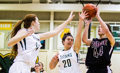 Kyle Grillot - kgrillot@shawmedia.com   Prairie Ridge sophomore Kirsten Voel-Pel puts up a shot under pressure from Boylan junior Halle Stull (34) and senior Casey Pettit during the fourth quarter of the girls class 4a sectional Tuesday in Crystal Lake. Boylan Catholic beat Prairie Ridge, 64-57.