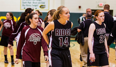Kyle Grillot - kgrillot@shawmedia.com   The Prairie Ridge team including senior Sarah Kilhoffer (14) and Aly Clark (22) walk off the court after the final play of the fourth quarter of the girls class 4a sectional Tuesday in Crystal Lake. Boylan Catholic beat Prairie Ridge, 64-57.