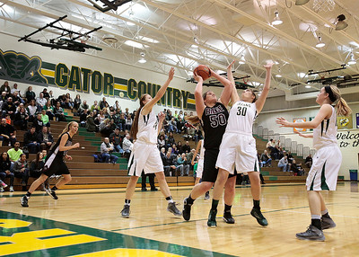 Kyle Grillot - kgrillot@shawmedia.com   Prairie Ridge senior Maddie Drain puts up a shot under pressure from Boylan senior Jane Horvat (30) during the second quarter of the girls class 4a sectional Tuesday in Crystal Lake. Boylan Catholic beat Prairie Ridge, 64-57.