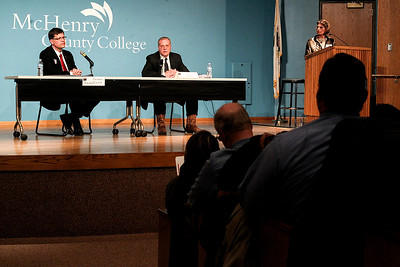 Sarah Nader- snader@shawmedia.com Andrew Zinke (left) and Bill Prim give their opening statements during the McHenry County Sheriff Candidates Debate sponsored by the League of Women Voters and the Northwest Herald at McHenry County College Tuesday, February 25, 2014.
