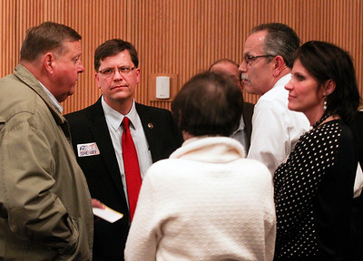 Sarah Nader- snader@shawmedia.com McHenry County Sheriff candidate Andrew Zinke (center) greets people before the McHenry County Sheriff Candidates Debate sponsored by the League of Women Voters and the Northwest Herald at McHenry County College Tuesday, February 25, 2014.