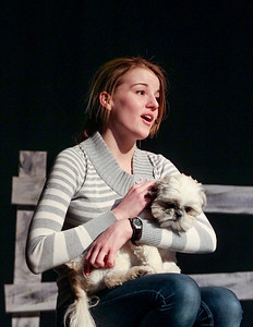 "Sarah Nader- snader@shawmedia.com Rachel Finnes hold the dog that plays Toto while singing a song during rehearsal for Richmond-Burton's spring musical, ""The Wizard of Oz"" on Tuesday, February 25, 2014. The musical opens on March 6 at 7 p.m.  and will also have shows on the March 8 at 7 p.m. and March 9 at 2 p.m."