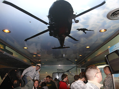 Crystal Lake South students take part in army simulation exercises aboard Adventure Semi 1 truck, a recruiting tool for the Army. (Jim Dallke - jdallke@shawmedia.com)