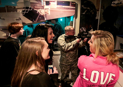Kyle Grillot - kgrillot@shawmedia.com   Crystal Lake South students including Will Orlyk, Molly Fremire, Iliyana Kovatchwatch, and Kathryn Halverson watch as Srgt. Joseph Burgess (center) demonstrates a simulated firing range inside the Adventure Semi 1 truck Wednesday in Crystal Lake. There are six Adventure Semi's that travel the United States, giving students a chance to simulate experiences, and find information on the various opportunities within the Army. After the Adventure 1 truck spent the day at Crystal Lake South, it plans to visit Woodstock North High School on Thursday and Cary-Grove High School on Friday.