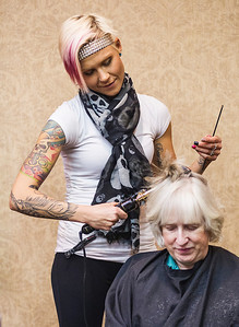 Kyle Grillot - kgrillot@shawmedia.com   Hair Stylist Jenna Wallner with Mario Tricoci Hair Salon does the hair of Joann Knaack of Cary during the Centegra Health Strong Woman Event Thursday in Crystal Lake. The event provides education, screenings, entertainment, and empowerment for women to make their health a priority. Attendees learn how to live longer, happier lives by bringing to their attention the various screenings and opportunities they could be involved with and places to go in the region.