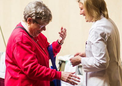 Kyle Grillot - kgrillot@shawmedia.com   Barbara Nyhus of McHenry (left) laughs with Dr. Kelly Holtkamp after a carpal tunnel screening on during the Centegra Health Strong Woman Event Thursday in Crystal Lake. The event provides education, screenings, entertainment, and empowerment for women to make their health a priority. Attendees learn how to live longer, happier lives by bringing to their attention the various screenings and opportunities they could be involved with and places to go in the region.