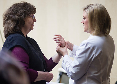 Kyle Grillot - kgrillot@shawmedia.com   Dr. Kelly Holtkamp (right) performs a carpal tunnel screening on Kathy Hartke of Fox River Grove during the Centegra Health Strong Woman Event Thursday in Crystal Lake. The event provides education, screenings, entertainment, and empowerment for women to make their health a priority. Attendees learn how to live longer, happier lives by bringing to their attention the various screenings and opportunities they could be involved with and places to go in the region.