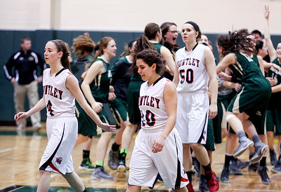 Sarah Nader- snader@shawmedia.com Huntley's Kaitlin Costantino (left), Kayla Barreto and Ali Andrews walk off the court after losing Thursday's Class 4A sectional final against Boylan February 27, 2014 in Crystal Lake. Huntley lost, 39-54.