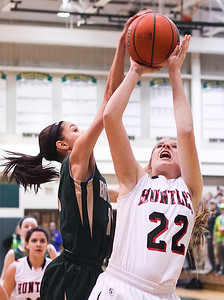 Sarah Nader- snader@shawmedia.com Boylan's Kayla Steward (left) blocks a shot from Huntley's Paige Renkosik during the third quarter of Thursday's Class 4A sectional final February 27, 2014 in Crystal Lake. Huntley lost, 39-54.