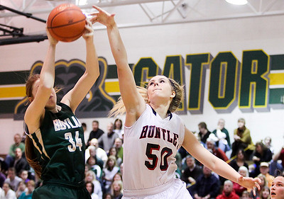 Sarah Nader- snader@shawmedia.com Boylan's Halle Stull (left) and Huntley's Ali Andrews go after the rebound during the fourth quarter of Thursday's  Class 4A sectional final February 27, 2014 in Crystal Lake. Huntley lost, 39-54.