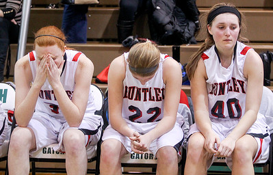 Sarah Nader- snader@shawmedia.com Huntley's Margaret Miller (left), Paige Renkosik and Samantha Andrews watch the last seconds of Thursday's  Class 4A sectional final against Boylan February 27, 2014 in Crystal Lake. Huntley lost, 39-54.