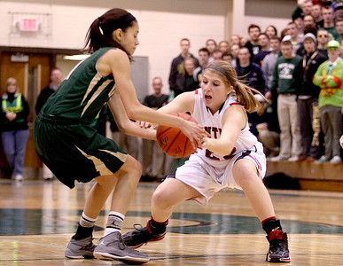 Sarah Nader- snader@shawmedia.com Huntley's Paige Renkosik grabs onto the ball during Thursday's Class 4A sectional final against Boylan February 27, 2014 in Crystal Lake. Huntley lost, 39-54.