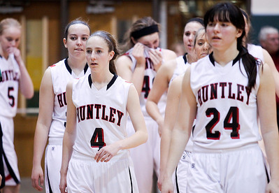 Sarah Nader- snader@shawmedia.com The Huntley basketball team walks off the court after losing Thursday's Class 4A sectional final against Boylan February 27, 2014 in Crystal Lake. Huntley lost, 39-54.