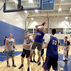 Members of the Geneva boys varsity basketball team practice at the school Wednesday afternoon.