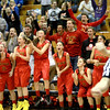 The Batavia bench erupts in the final seconds of their 57-52 4A Addison Trail Sectional win over Downers Grove North Tuesday.
