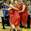 Batavia's Liza Fruendt (left) celebrates with teammate Morgan Erickson following their 57-52 4A Addison Trail Sectional win over Downers Grove North Tuesday.