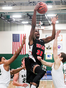 Sarah Nader- snader@shawmedia.com Huntley's Amanze Egekeze shoots during the fourth quarter of Friday's FVC crossover game against Grayslake Central February 28, 2014 in Grayslake. Huntley defeated Grayslake Central, 55-45.