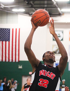 Sarah Nader- snader@shawmedia.com Huntley's Amanze Egekeze shoots during the third quarter of Friday's FVC crossover game against Grayslake Central February 28, 2014 in Grayslake. Huntley defeated Grayslake Central, 55-45.