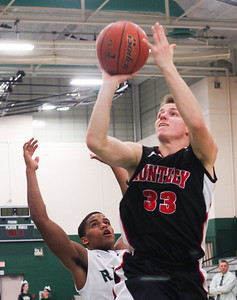Sarah Nader- snader@shawmedia.com Grayslake Central's Malcolm Reed (left) guards Huntley's Zach Gormey while he shoots during the third quarter of Friday's FVC crossover game February 28, 2014 in Grayslake. Huntley defeated Grayslake Central, 55-45.