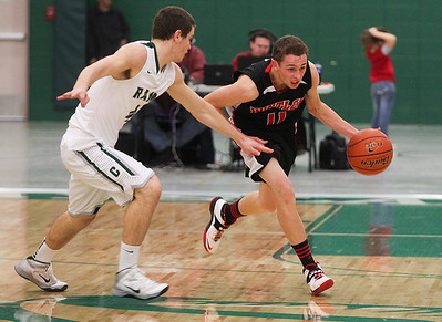 Sarah Nader- snader@shawmedia.com Grayslake Central's Jacob Vargo guards Huntley's Brad Spoeth while he dibbles towards the basket during the third quarter of  Friday's FVC crossover game February 28, 2014 in Grayslake. Huntley defeated Grayslake Central, 55-45.