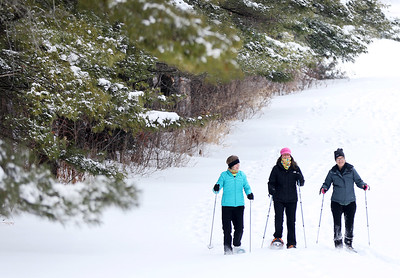 Kyle Grillot - kgrillot@shawmedia.com  Jennifer Hill (from left), Tricia Harding, and Cathy Gillaspie, all of Woodstock, snowshoe through Emricson Park Wednesday, January 4, 2015 in Woodstock.