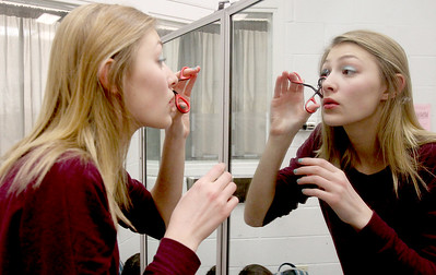 "Sarah Nader - snader@shawmedia.com Kayla Lewis, 15, of Algonquin puts on makeup for Monday's dress rehearsal of ""Legally Blond the Musical"" produced by Jacobs HIgh School February 9, 2015. The story is based on the novel ""Legally Blonde"" by Amanda Brown and the 2001 film of the same name. Performances  are Thursday, February 12 through Saturday, February 14, at  7:00 pm  and Sunday, February 15 at 1:00 pm  with tickets $10 a person."