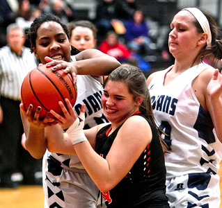 Michelle LaVigne/ For Shaw Media Cary-Grove's Vanessa Morris (10) Crystal Lake Central's Kathleen Penza (14) during the opener of Class 4A McHenry Regional in McHenry on February 15, 2016.